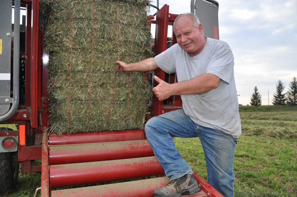 Organic hay farmer Tom Parkins of Alvinston, ON, had a good year, even with the rain and cool weather experienced in southwestern Ontario.  Photo by Owen Roberts