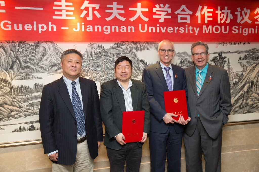 Minister Leal poses with, Dr. Franco J. Vaccarino, president of the university of Guelph and  Jiangnan University officials at a MOU signing between the U of G and JU in Wuxi, China, April 22, 2015.